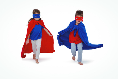 fond of children: Masked kids running pretending to be superheroes on white screen Stock Photo