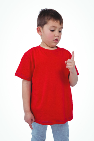 unsmiling: Unsmiling boy looking at his finger on white screen