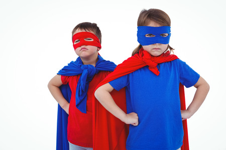 fond of children: Masked kids pretending to be superheroes on white screen Stock Photo