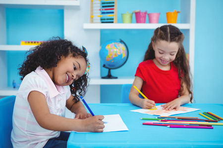 drawing room: Cute girls drawing in playing room Stock Photo