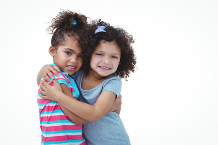 fond of children: Cute girls hugging and looking at camera on white screen