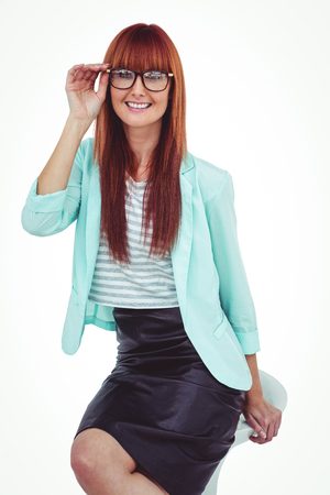 attractive  female: Portrait of a smiling hipster woman against white background