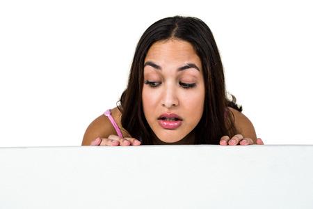 peeking: Close-up of woman peeking against white background