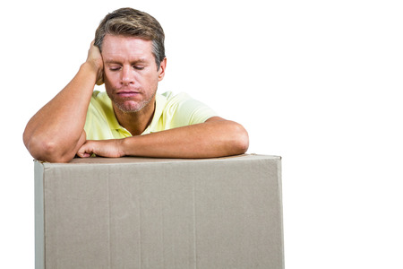 dreariness: Close-up of sad man with box