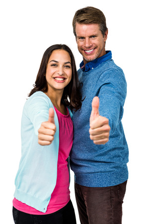 thumps up: Portrait of happy couple gesturing against white background Stock Photo