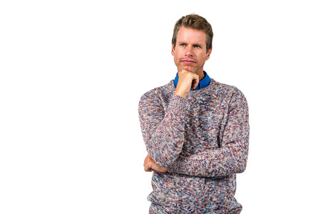 causal clothing: Close-up of thoughtful man against white background