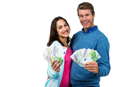 rich people: Portrait of couple showing money against white background Stock Photo