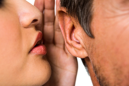 Close-up of woman whispering in man ear Stock Photo