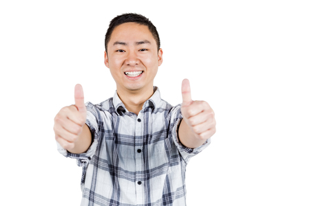 thumps up: Happy man showing thumps up against white background