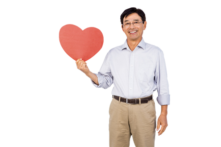 chinos: Older asian man showing heart on white background