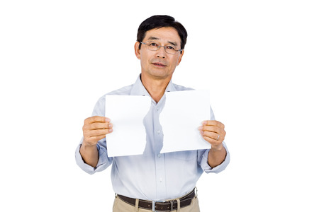 chinos: Older asian man showing ripped page on white background