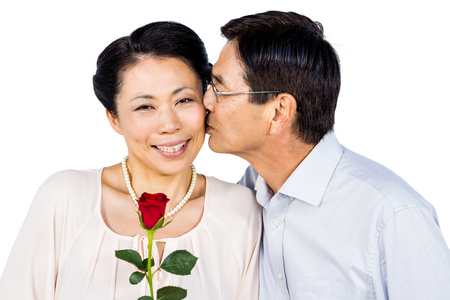 mature couples: Older asian couple with rose on white background