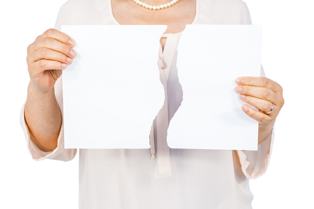 strife: Woman holding ripped page on white background