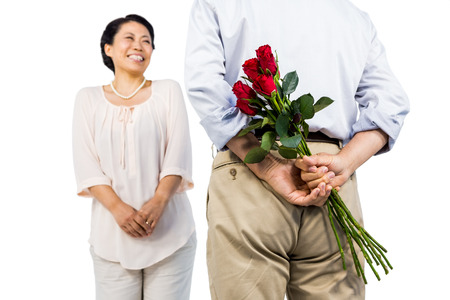 senior men: Older asian couple with roses on white background