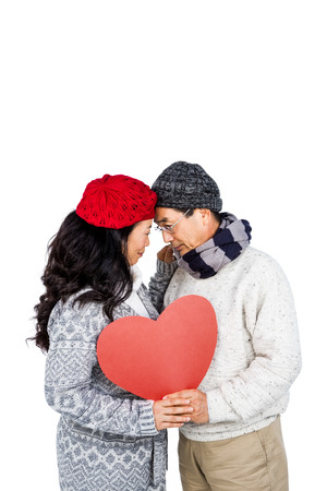 lady in red: Happy couple with balloon against white background Stock Photo