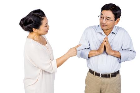 argument: Older asian couple having an argument on white background