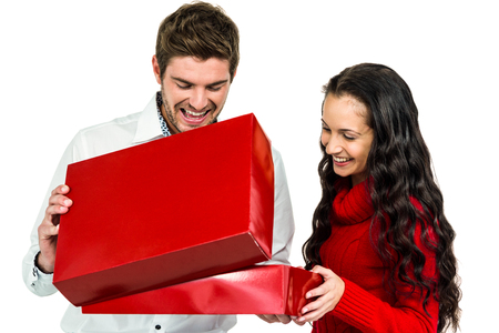 opening gift: Smiling couple opening gift box on white screen