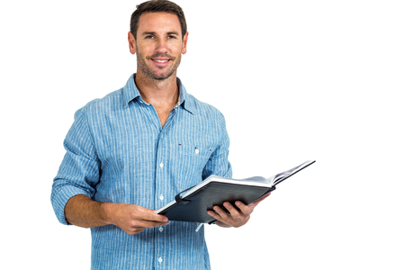 man holding book: Smiling man holding book on white screen Stock Photo