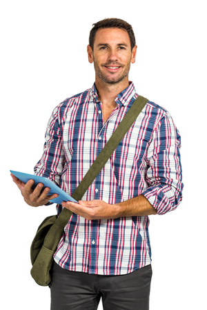 shoulder bag: Smiling man with shoulder bag using tablet and looking at the camera on white screen