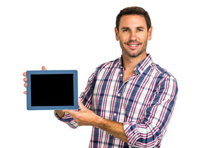caucasian white: Young man showing tablet screen at camera on white screen Stock Photo