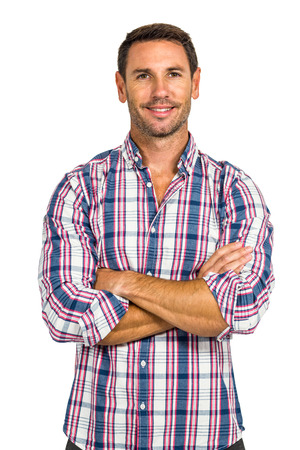 blue button: Portrait of smiling man with arms crossed on white screen