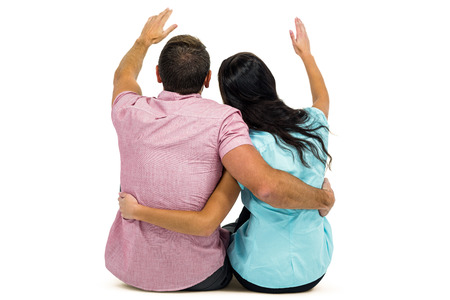 arm around: Rear view of couple with arm around while sitting on white screen