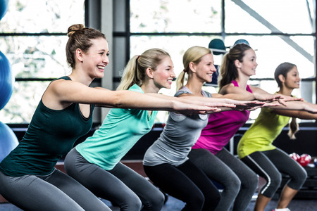 Fitness class doing exercises in the gym Stock Photo