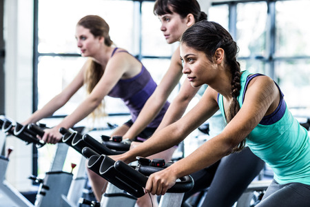 Fit woman working out at spinning class in the gym Reklamní fotografie