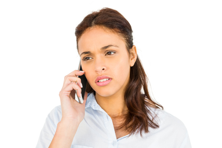 cut out device: Worried casual woman on phone on white background