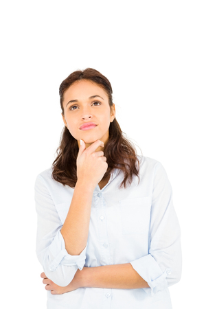 chin: Thoughtful woman with finger on chin against white background