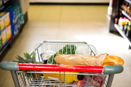 filled: View of filled shopping cart at supermarket Stock Photo