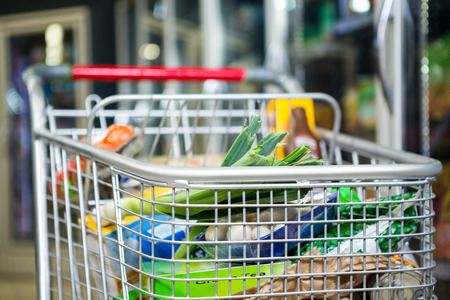 filled: View of filled shopping cart in supermarket