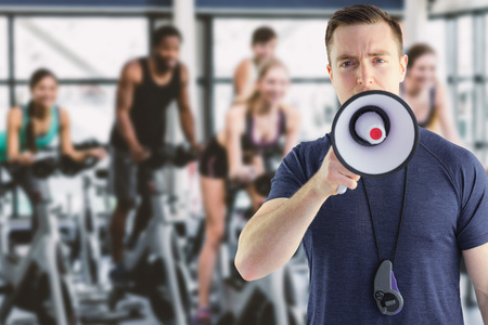 well read: Composite image of male trainer yelling through the megaphone Stock Photo