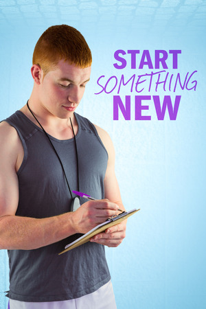 writing western: Fit personal trainer writing on clipboard against blue background