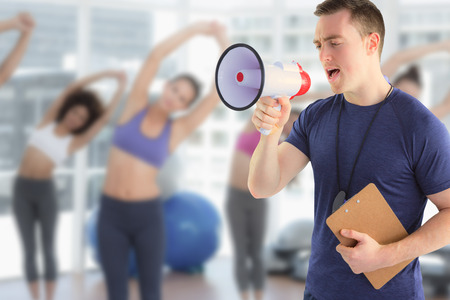 yelling: Composite image of male trainer yelling through the megaphone Stock Photo