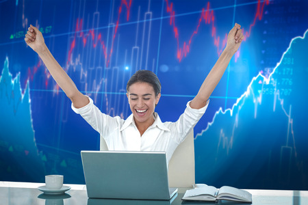 winning stock: Businesswoman celebrating a great success against stocks and shares Stock Photo