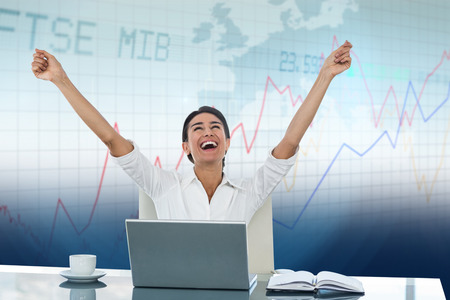 great success: Businesswoman celebrating a great success against stocks and shares Stock Photo