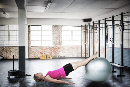 gym room: Woman doing pilates against gym
