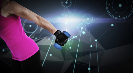 weightlifting gloves: Muscular woman exercising with dumbbells  against glowing background with lines