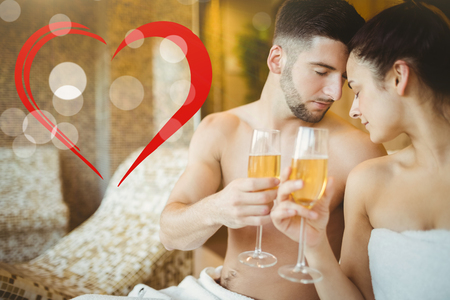 heart suite: Romantic couple together with champagne glasses against heart Stock Photo