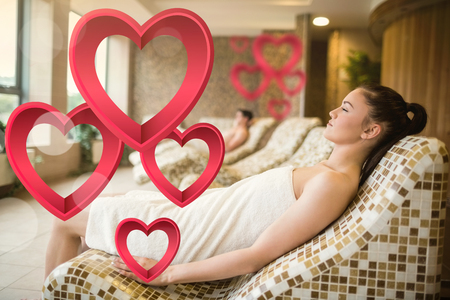 heart suite: Couple relaxing in the thermal suite against pink hearts