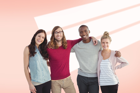 arms around: Portrait of smiling business team with arms around against red vignette