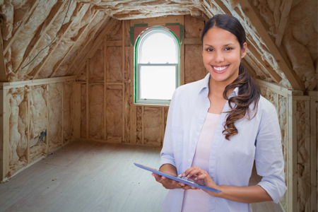 house under construction: Woman using tablet pc against room in house under construction