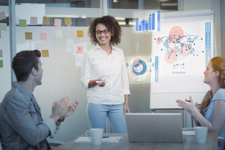 appreciating: Digital pie chart  against colleagues appreciating businesswoman in meeting