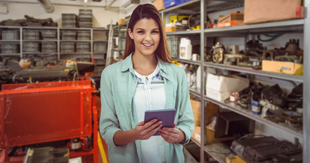 rack arrangement: Pretty girl with tablet against equipments on shelf in factory