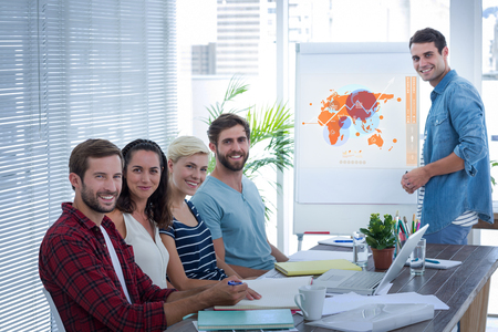 mid adult men: Futuristic interface with the world map  against businessman giving a presentation