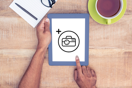 cropped: Photography apps against cropped image of man using on digital tablet