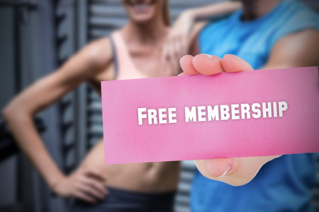 membership: The word free membership and young woman holding blank card against