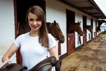 reigns: Smiling jockey posing for camera in the countryside LANG_EVOIMAGES