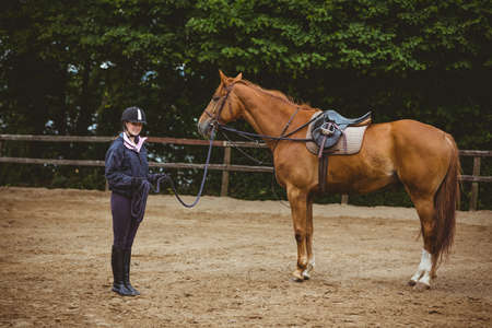 cantering horse: Female rider leading her horse in the countryside
